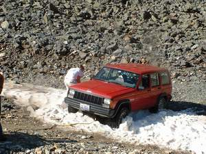 Person stuck in snowbank high in the Rockies